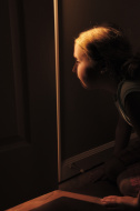 stock-photo-10395897-girl-peeking-through-cracked-door