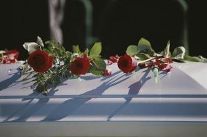 roses-cover-the-casket-of-an-officer-stephen-st-john